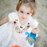 Little girl playing in the sand.